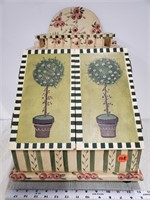 Letter box painted with garden scene