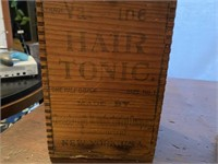 Early Hair Tonic Box with Modern Lamp