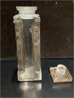 Lalique perfume bottle, holes in 2 corners
