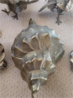 Brass Roosters, Magnolias, and Seashell