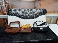 Two purses, one Victoria's Secret Carryall, one