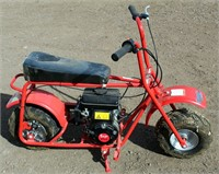 Lot # 5030.  Doodle Bug Mini Bike.   Absentee bidding available on this item.  Click catalog tab for more information