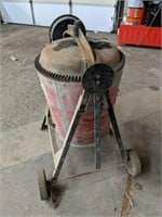 Portable cement mixer measuring 42 x 36""