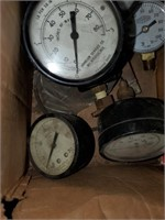 "Various size pressure gauges largest measuring 4"""