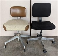 Two cushioned swivel chairs. About 25-30in tall