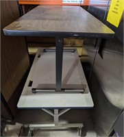 """Small table measuring 48 x 24 x 30"""" and rolling"""