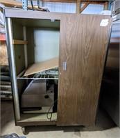 Large rolling pressboard cabinet measuring 48 x