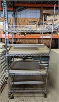 Metal rolling rack with shelving parts lot