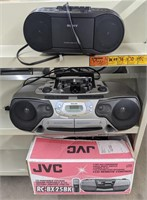Three CD player stereos.JVC, Philips, Sony.