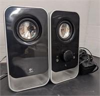 Three pairs of Logitech brand speakers. Bidding