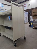 Three tiered two sided Metal cart. Contents not