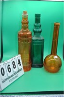 3 Decorative colored glass bottles