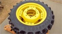 2- John Deere wheels with 9.5-24 tractor tires.