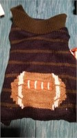 "Football sweater size XL, L=9.5"" Reg $21"