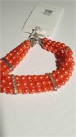 9 Coral triple strand pearl necklaces