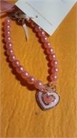 5 Pink necklaces w/ pink heart s/m/L. Reg $15 ea