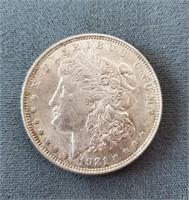 Four 1921 US Morgan Silver Dollars