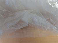 Partial box of Woven Plastic Sheeting.  Full box