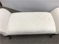 White upholstered window bench