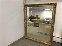 Lovely contemporary gold framed mirror