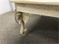 Tile top table with elephant legs