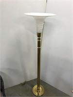 Brass torchiere floor lamp with glass shade