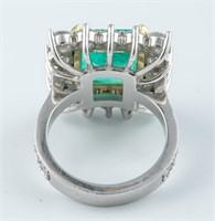 Platinum 18k emerald and diamond ring.