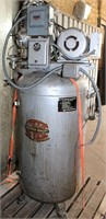 Lot 5052 - Champion Upright Air Compressor.  Absentee bidding available on this item. Click catalog tab for more information & pictures.