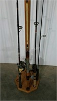 Fishing pole stand with four rods, three with