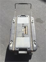 Rolling toolbox with contents.
