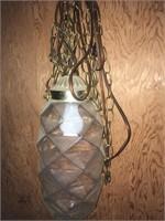 Hanging light, grass plugger, log chain