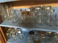 Three shelves of jars