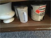 Two shelves full of plasticware
