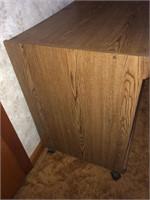 Pressed wood shelf unit on wheels