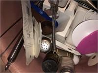 Round plastic tub with kitchen utensils