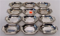 "12 Tiffany & Co. Sterling ashtrays, 2.5"" x 4"" long"