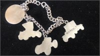 Ford Motor Company charm bracelet and a