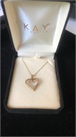 Heart 10K gold and white stone necklace