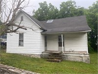 ABSOLUTE REAL ESTATE AUCTION: HOUSE AND LOT