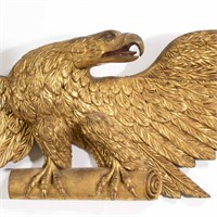 Detail of a fine 19th century American carved and gilded spread-wing eagle wall plaque