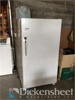 Upright white single door freezer as