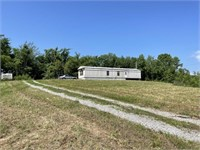 1+/- Acre Lot &  Neglected Mobile Home