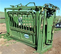 Lot 5008- Powder River Cattle Squeeze Chute   Absentee bidding available on this item. Click catalog tab for more information & pictures.
